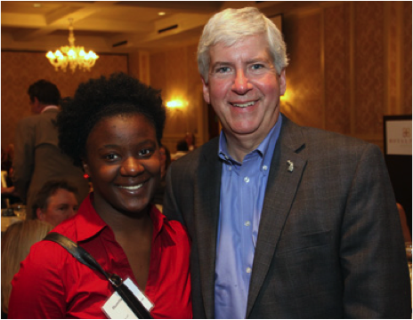 Foster care alumna Shanetta Young (left) with Governor Rick Snyder (right)