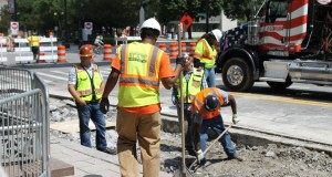 Construction workers on a Detroit road (Daily Detroit file photo)