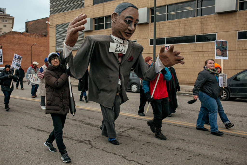 The Matrix Theater Company brought their puppets of relevant civil rights icons to the demonstration, like, their puppet of Ralph Bunche, the first person of color to be honored with the Nobel Peace Prize.