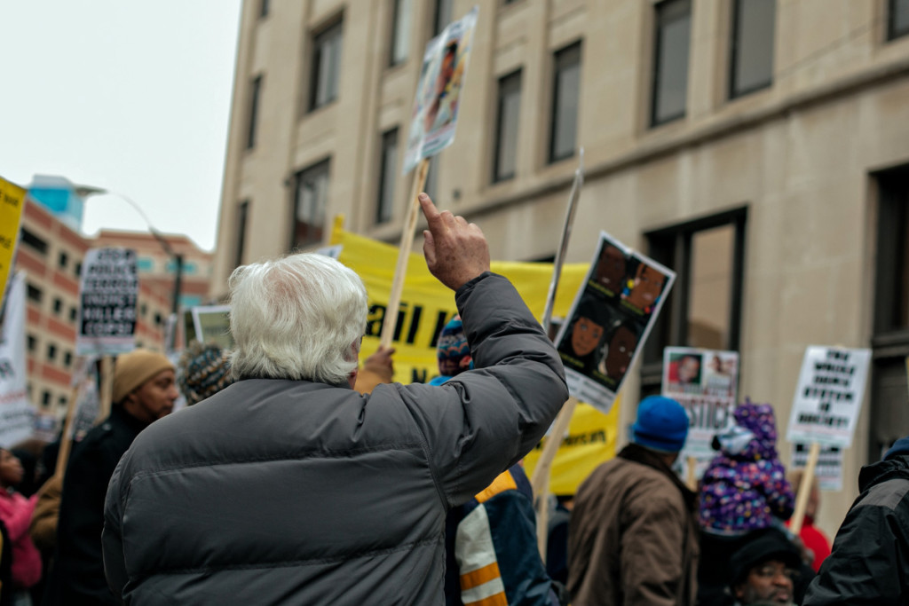 """The protestors paused at the Water Board Building on Randolph St. downtown to jeer and chant, """"Stop water shut offs!"""""""