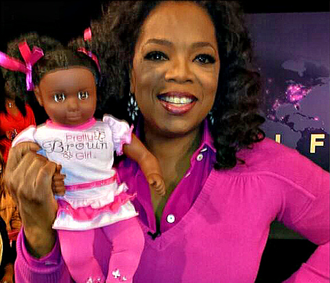Oprah Winfrey shows off the Pretty Brown Girl doll