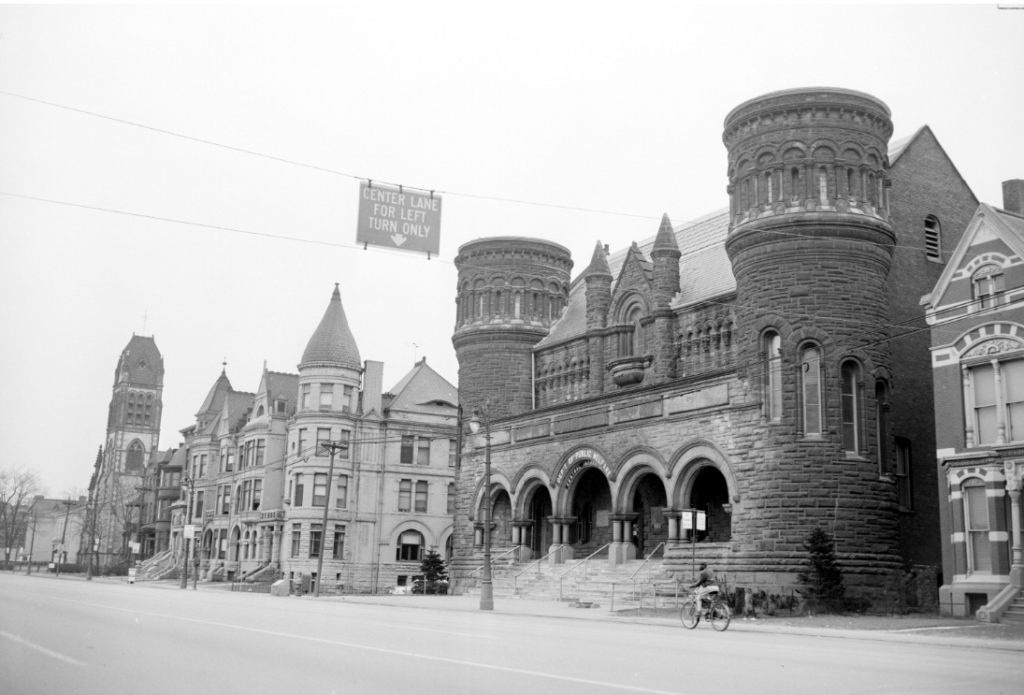 Detroit Museum of Art when it was used as the Public Welfare Department building. The turrets were removed from its two towers in the 1930s. Picture dated April 10, 1956. Walter P. Reuther Library, Archives of Labor and Urban Affairs, Wayne State University