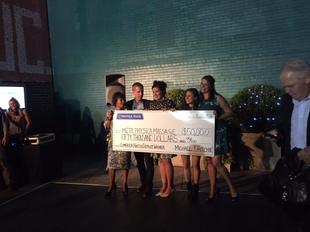 Winners of Hatch Detroit pose with a check. Photo: Shianne Nocerini