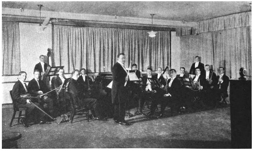 1922 Detroit News Orchestra broadcast. The large round unit atop the stand on the far right is the pick-up microphone.