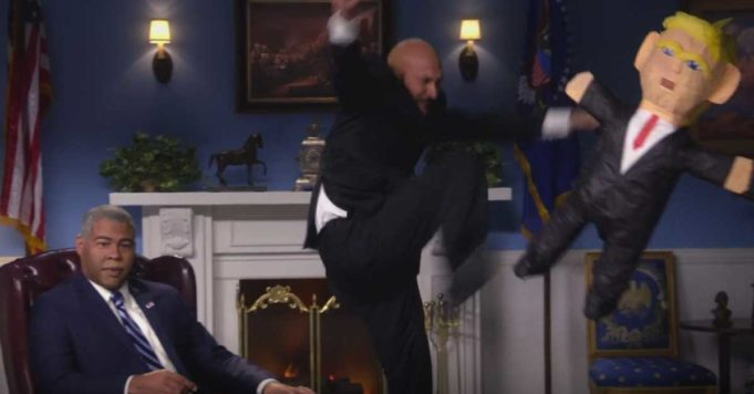 Keegan Michael Key kicks a Trump Pinata